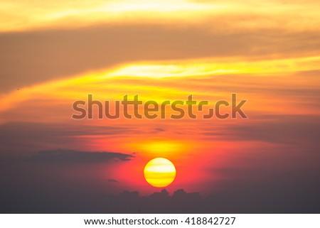 Egg Yolk Sunset / Fiery orange sunset sky. Beautiful sky - stock photo