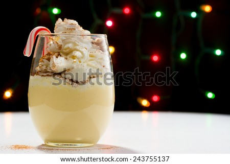 Eggnog with Whipped Cream and Cinnamon - stock photo