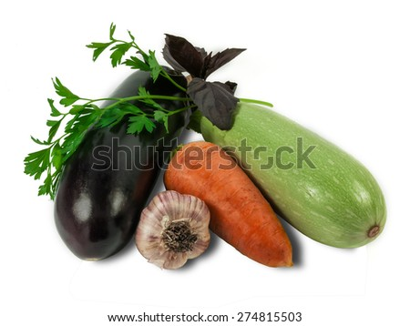 Eggplant, carrot, vegetable marrow, garlic and branch of parsley and basil on a light background. Isolation.