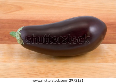 Eggplant on Wood Table - stock photo