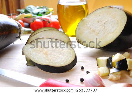 eggplant prepared on cutting board to be cooked - stock photo