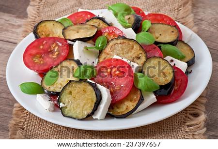 Eggplant salad with tomato and feta cheese - stock photo