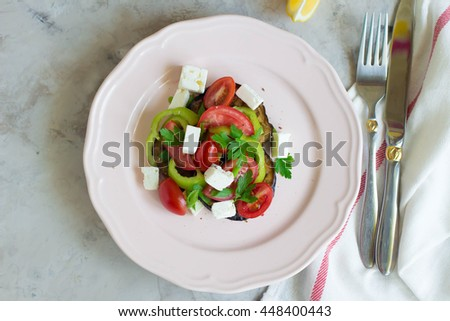 Eggplant salad with tomato,pepper and feta cheese. Concept of healthy eating. Place for text.  - stock photo