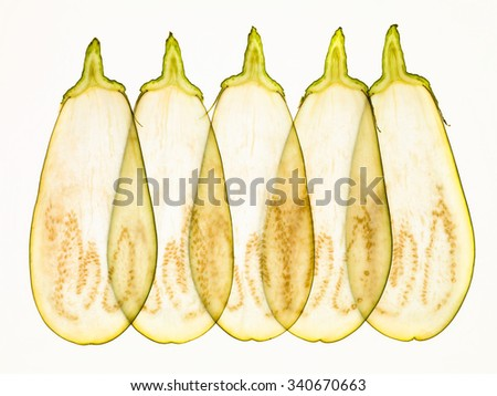 Eggplant slices texture backlit illuminated arranged in line - stock photo