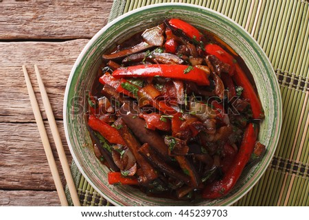 Eggplant Stir-Fry from Asian-style close-up on a plate. horizontal view from above  - stock photo