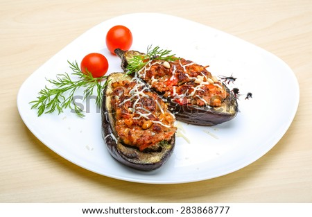 Eggplant stuffed minced meat with tomato, cheese and herbs - stock photo