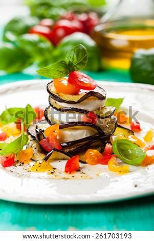 Eggplant, Tomato and Mozzarella Stacks on plate - stock photo