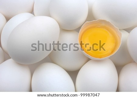 Eggs and egg yolk - stock photo