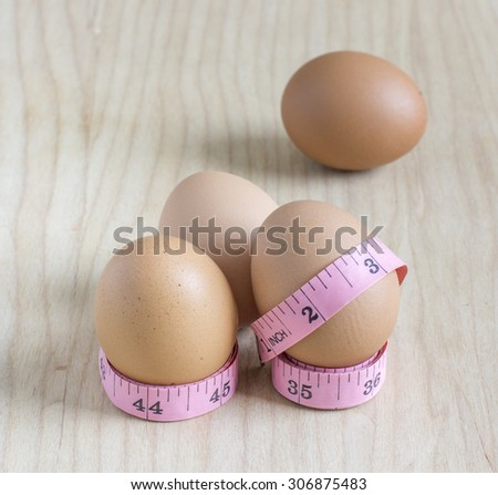 Eggs and Measure tape, Should eat right to lose weight   - stock photo