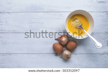 Eggs and red onion with space on background - stock photo