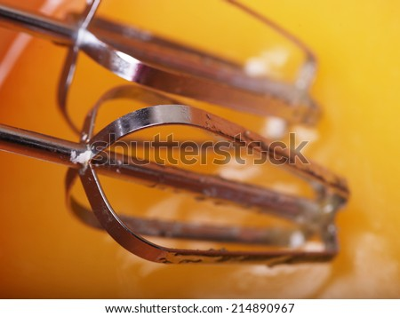 Eggs and sugar in mixing bowl prepare for bake. Homemade food. - stock photo
