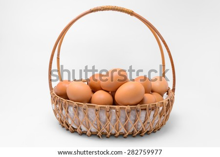 Eggs collection in basket isolated on white background  - stock photo