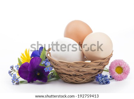 Eggs in a Basket on wooden  - stock photo