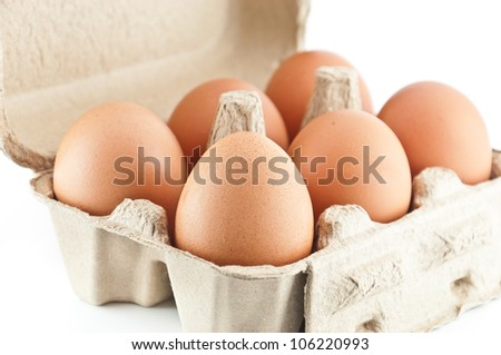 eggs in a carton isolated on white background - stock photo
