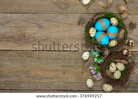 Eggs in a nest on a wooden background, Easter concept - stock photo