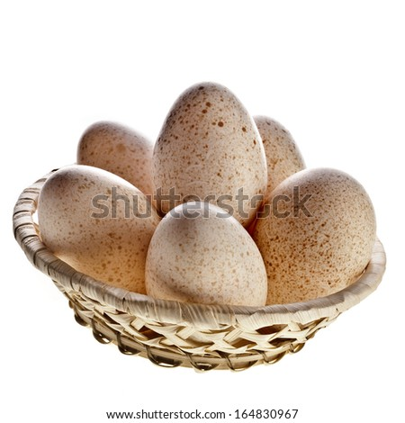 Eggs in basket  isolated on white background with clipping path  - stock photo