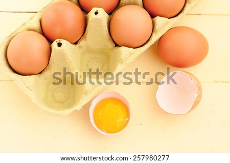 Eggs in the package. Yolk in shell - stock photo