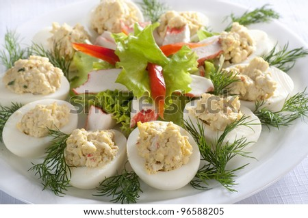 Eggs stuffed with crab sticks - stock photo