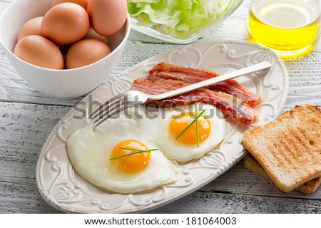 eggs with bacon and toasted bread - stock photo