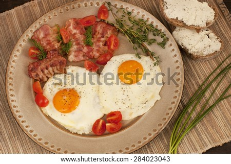 Eggs with toast and bacon for breakfast - stock photo