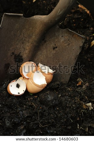 eggshells inside the compost bin with shovel - stock photo