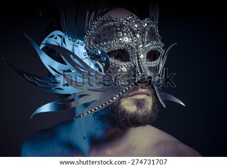 Ego, bearded man with silver mask Venetian style. Mystery and renaissance - stock photo