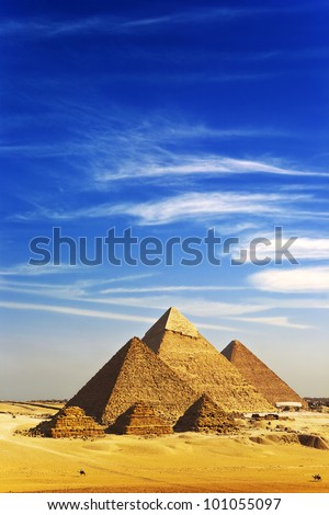 Egypt. Cairo-Giza. General view of pyramids from the Giza Plateau (there is three pyramids known as Queens' Pyramids on front side; next in order from left: the Pyramid of Menkaure, Khafre and Chufu) - stock photo
