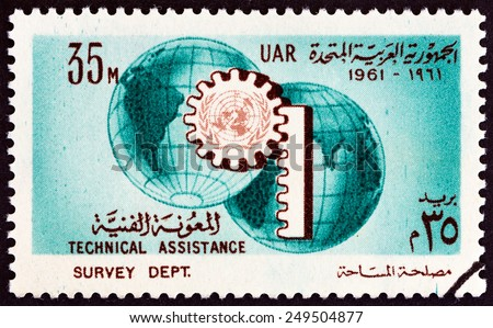 EGYPT - CIRCA 1961: A stamp printed in Egypt issued for the UN Technical Assistance Program and 16th anniversary of the UN shows Globe and Cogwheel, circa 1961.  - stock photo
