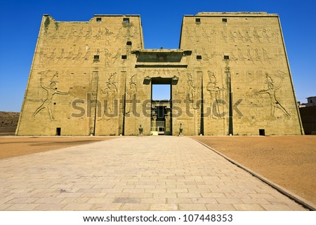 Egypt. Edfu. The Temple of Horus (also known as the Temple of Edfu) - the first pylon with the main entrance. - stock photo