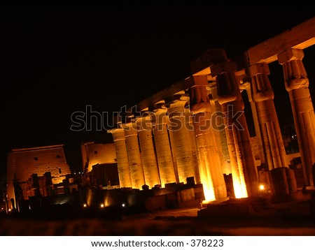 Egypt: Giant columns in the temple of Luxor at night - stock photo