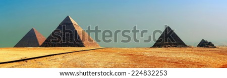 Egypt panorama pyramid with high resolution. Pyramids of ancient Egypt. Sand pyramid. Icon pyramid. Panorama pyramids. Horizontal pyramid. Egyptian pyramid. Pyramids in the desert near the road. Cairo - stock photo