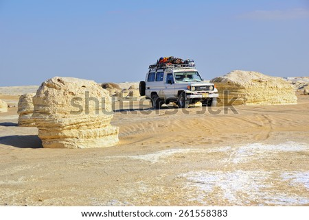 EGYPT, SAHARA - DEC 26, 2008: Off-road car shown in the Tent valley desert. Extreme desert safari is one of the main local tourist attraction in Egypt - stock photo