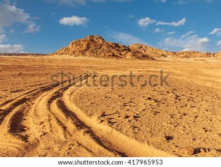 Egypt Sinai desert view  road, hills, blue sky - stock photo