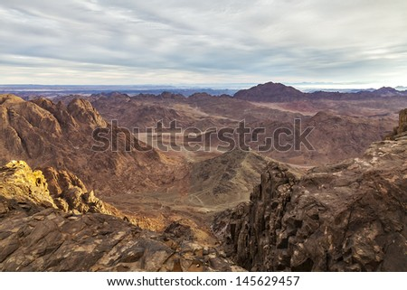 Egypt, Sinai, Mount Moses. Road on which pilgrims climb the mountain of Moses. In the distance, Mount St. Catherine, (2637 m.). - stock photo