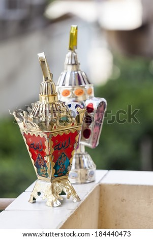 Egyptian lantern on balcony wall - fanous Ramadan  - stock photo