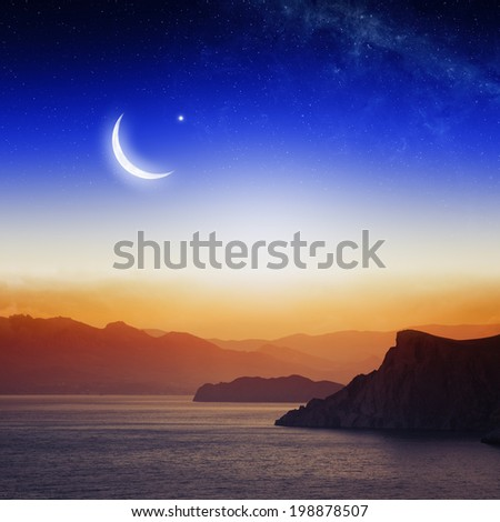 Eid Mubarak background with moon and stars, holy month, Ramadan Kareem,  beautiful red sunset, mountain silhouettes. Elements of this image furnished by NASA - stock photo