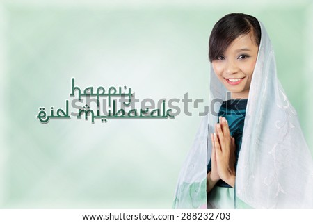 Eid Mubarak. Composition of typography in Arabic style with image of smiling muslim woman, over light green abstract background - stock photo