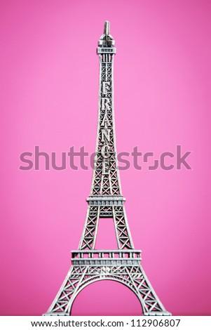 Eiffel model on colorful background - stock photo