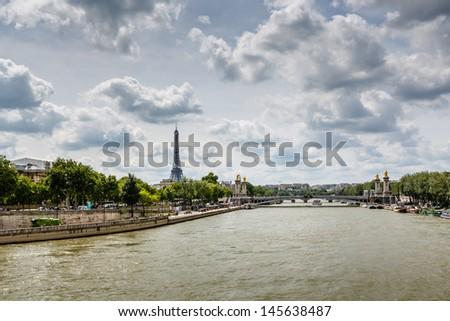 Eiffel Tower and Alexander the Third Bridge, Paris, France - stock photo