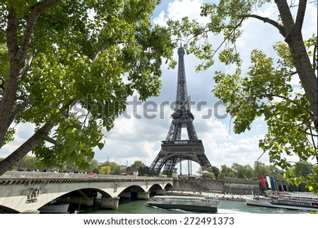 Eiffel tower and Jena bridge in a spring cloudy day, Paris, France - stock photo
