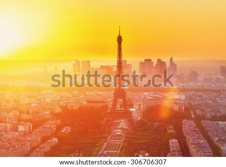 Eiffel Tower  and Paris cityscape from above in orange sunset sunlight, France - stock photo