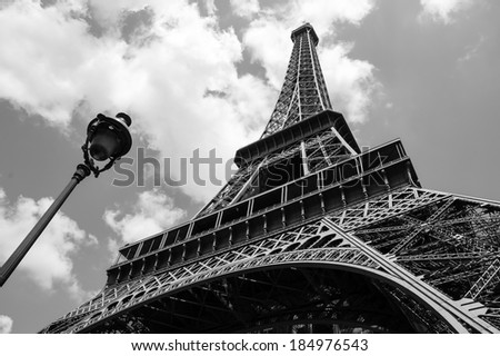 Eiffel tower and parisian streetlight. Black and white. - stock photo