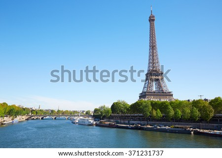 Eiffel tower and Seine river in a clear sunny day in Paris - stock photo