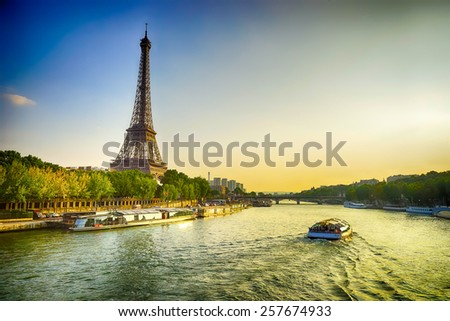 Eiffel Tower and Seine river in the evening - stock photo
