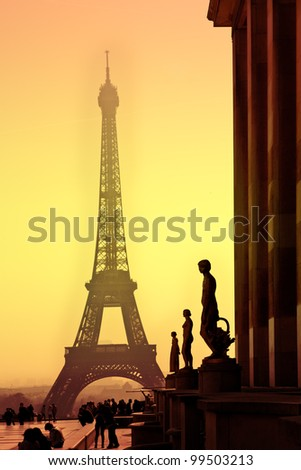 Eiffel Tower and silhouettes of sculptures. View from the Trocadero. Sanset. - stock photo
