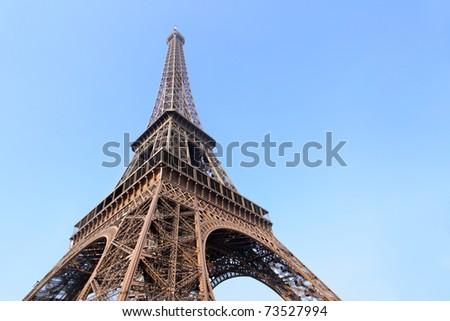 Eiffel tower close-up against blue sky, Paris, France. - stock photo