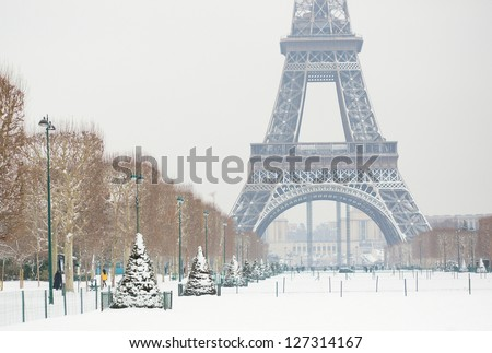 Eiffel tower covered with snow - stock photo