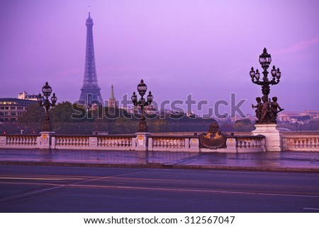 Eiffel tower in Paris at sunset - stock photo