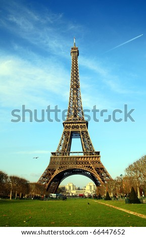 Eiffel tower in Paris, France: Eiffel tower shot from Champ de Mars on very cold winter day - Trocadero can be seen at distance under tower. - stock photo