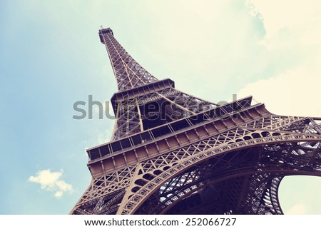 Eiffel Tower in Paris, France on a blue sky  - stock photo